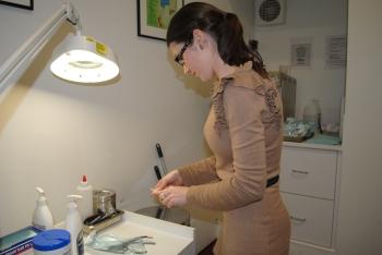 Leah preparing podiatry equipment